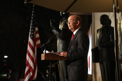 David Eisenhower stands beside a sculpture of his grandfather, Dwight D. Eisenhower, as he makes remarks at the dedication of the new memorial to the 34th President of the United States.