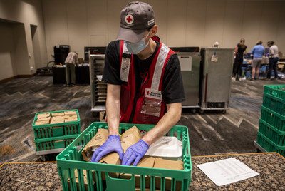 American Red Cross volunteer Kalen Pippins, helps to get meals ready to deliver to evacuees from the Oregon wildfires who are staying in hotel shelters in Eugene, Oregon. (Photo by Scott Dalton/American Red Cross)