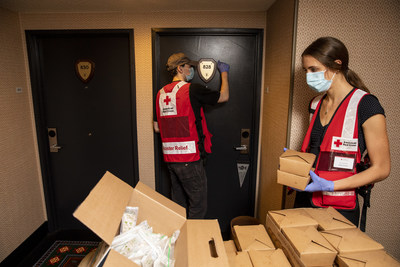 American Red Cross volunteers deliver meals to evacuees at a hotel that is being used by the American Red Cross as a shelter in Eugene, Oregon. (Photo by Scott Dalton/American Red Cross)