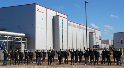 The initial group of employees for SK Battery America's facilities in Georgia stand in front of the first plant at site. SK Battery America has 60 employees with plans to hire more than 1,000 by the end of next year at the site in Commerce, Ga., to make batteries for electric vehicles.