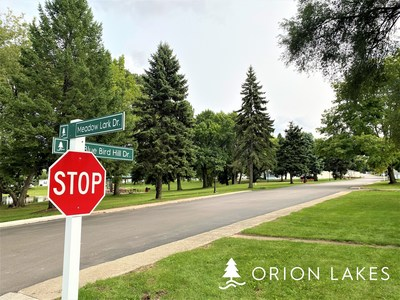 Large pine trees lend shade and beauty to residents at Orion Lakes.