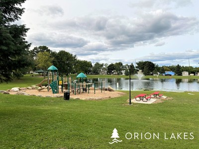 Orion Lakes residents enjoy beautiful natural surroundings, including a lake and lush greenery.