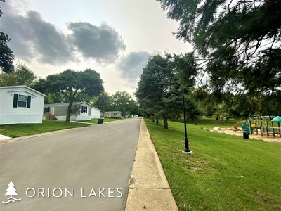 Among the community updates made by Havenpark Communities to the Orion Lakes community include new roads and a lakeside playground.
