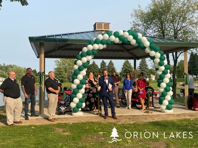 Township Supervisor Chris Barnett addresses the residents, local officials, and residents at the Orion Lakes ribbon-cutting ceremony.