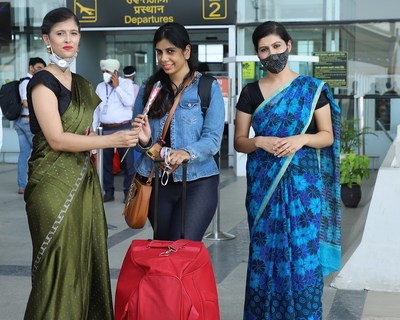 Students and faculty of University Institute of Tourism and Hospitality Management, Chandigarh University welcoming the tourists at Chandigarh International Airport to mark the celebrations of World Tourism Day (PRNewsfoto/Chandigarh University)