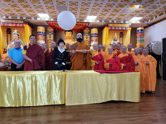Chairperson Suzi Leggett handed the Pope of Buddhism Scepter to Venerable Mozhi Rinpoche, representative of World Buddhism Association Headquarters, for the Scepter to be returned to His Holiness Dorje Chang Buddha III.