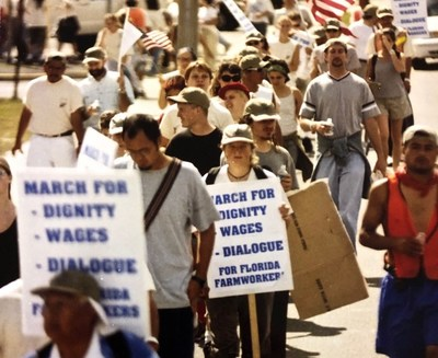 Steve Hitov (back and left, with cap) consulting with CIW Co-Founder Lucas Benitez during the March for Dignity, Dialogue, and a Fair Wage (2000)