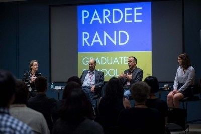"""[Photo of panel] Steve Hitov (second from left) on panel with CIW Co-Founder and MacArthur """"Genius"""" Fellow Greg Asbed (second from right) and Dean Susan Marquis (far left) at the Pardee RAND Graduate School (2018 Photo Credit: Diane Baldwin/RAND Corporation)"""