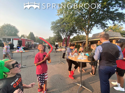 Springbrook Estates residents and other attendees enjoyed complementary food and entertainment by local establishments.