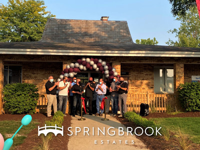 Springbrook Estates community staff celebrate in front of the community office after the ribbon-cutting ceremony.