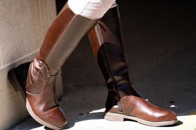The Nova EH Safety Riding Boot from Xena Workwear is a first-of-its-kind steel toed shoe. The tall boot hits just a few inches below the knee for extra coverage, features a low heel with a slip-resisting outsole and electrical hazard certification (EH).