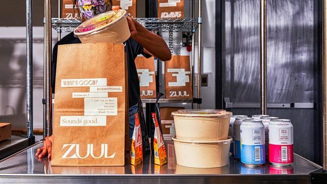 A Zuul employee prepares a Zuul Market order for delivery. Photo Credit: Nico Shinco