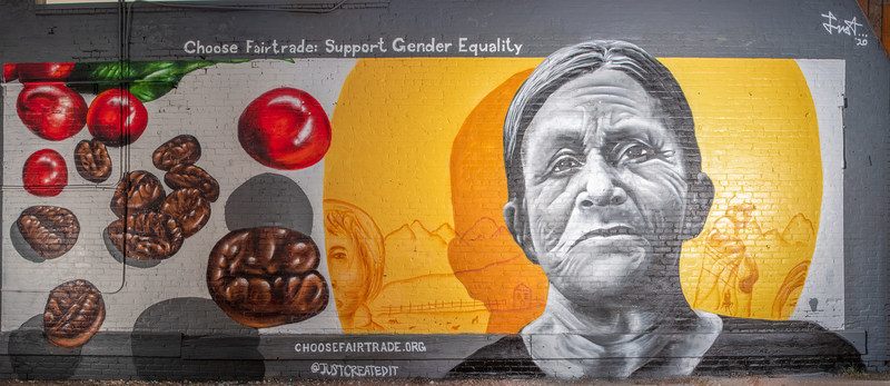 """Natividad Vallejos Mural, by Giovannie """"Just"""" Dixon, located at the East Evans Avenue Kaladi Coffee Roasters, Denver. This mural is one of three commissioned by Fairtrade America for its Choose Fairtrade:  Choose the World You Want campaign."""
