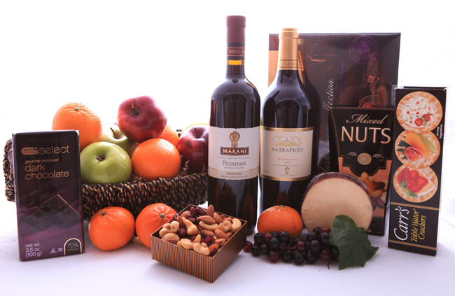 Send everyone on your office holiday list a delicious gourmet gift with GiftBasketsOverseas.com