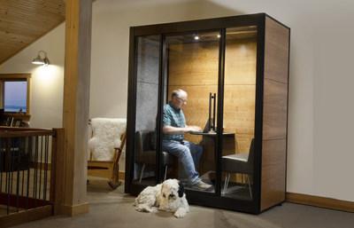 Glenn Bostock sits in his SnapCab Meet 2 home office pod alongside Wilson the dog. (CNW Group/SnapCab)