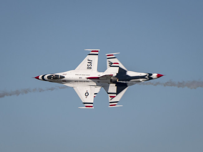 The solo pilots from the U.S. Air Force Thunderbirds in a close head-to-head pass.