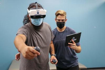 Physical therapist and patient utilize XR Therapy System by Neuro Rehab VR