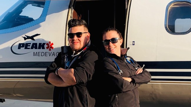 Roman Valles with his colleague and friend who was also the nurse caring for him on his flight home