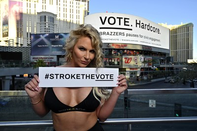 Brazzers exclusive adult entertainment star Phoenix Marie poses in front of voting PSA billboard at Harmon Square in Las Vegas, encouraging Americans to vote.