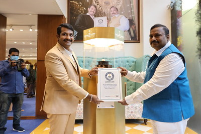 Kotti Srikanth with father Chandubhai with the Guinness World Record certificate