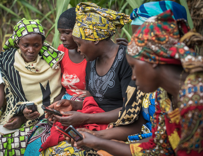 Women in Rwanda use mobile technology from DreamStart Labs to run an informal community bank. These digital savings groups help previously unbanked people to save money, build credit history, access loans, and achieve financial goals.