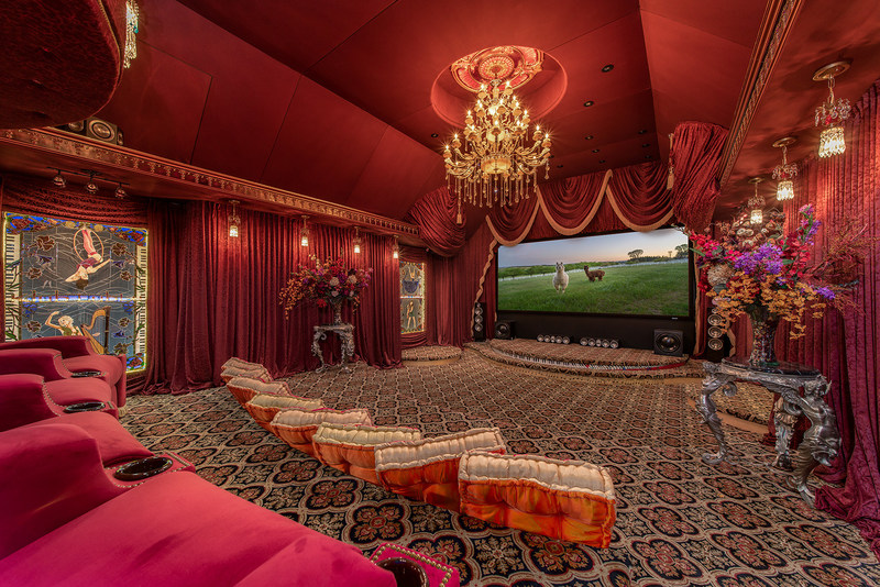 Shown here: the home theater. The vibrant colors and design were inspired by Russia's Bolshoi Theater in Moscow. Learn more at OregonLuxuryAuction.com.