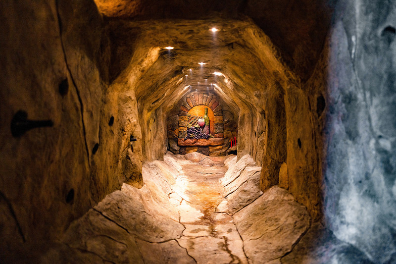 "Although the owner did not take advantage of the property's ability to support vineyards, he did create a subterranean ""wine grotto"" and tasting room. The grotto is accessible via a ""secret"" door and includes in-wall lighting and storage for 100 select bottles. Learn more at OregonLuxuryAuction.com."