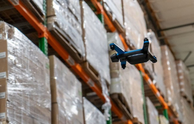 Ware drone flying in a warehouse and collecting inventory data.