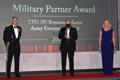 Retired U.S. Army Gen. John Nicholson, President, PenFed Foundation (left) and Hon. Deborah Lee James, Chairwoman of the Board, PenFed Foundation and former Secretary of the Air Force (right) present Retired U.S. Army Lt. Gen. Raymond Mason, Director of Army Emergency Relief (center) with the Military Partner Award.