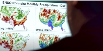 Physical scientist Anthony Arguez reviews El Niño and La Niña climate data at NOAA/National Centers for Environmental Information. Courtesy: NOAA