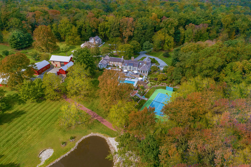 """Stone Creek Farm, a 50-acre estate and hobby farm in Delaware Twp, NJ is up for sale via luxury auction® on October 31. The property was originally home to a stone farmhouse from the 18th century, but is now a modern, luxury estate with a pool and spa, tennis court and a unique, """"3-barn"""" complex with entertainment and utility areas. Platinum Luxury Auctions and Callaway Henderson Sotheby's International Realty are working together for the sale. Learn more at NewJerseyLuxuryAuction.com."""