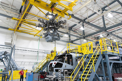 Newly-installed 10-ton cranes lift a 12,000 lb. gearbox into a CH-53K heavy-lift helicopter on Sikorsky's final assembly line in Stratford, Connecticut on Oct. 19, 2020. Photo courtesy Sikorsky, a Lockheed Martin company.