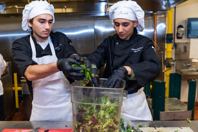 ProStart students prepare mixed greens for the Taste of the NFL, held in Miami in February 2020. ProStart students working in the industry will now have direct connections to the NRAEF's Restaurant Management and Line Cook apprenticeship tracks.