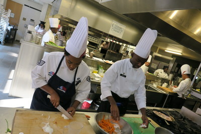 Military foodservice professionals prepare dishes during the NRAEF's Advanced Training Culinary Program, hosted quarterly. The NRAEF's Valor program supports transitioning military service members with direct entry ways into restaurant management apprenticeship.