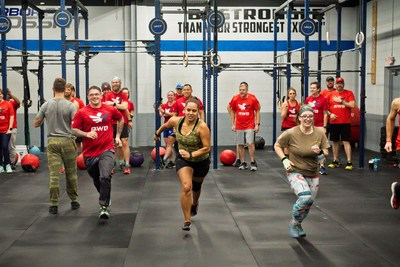 Team Red, White & Blue members participate in WOD for Warriors in 2019.