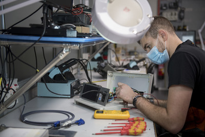 In the electronics laboratory, Adrián Hitos checks that the machines are working correctly for the last time.
