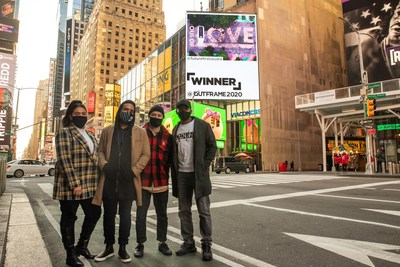 Future First Studio team with their winning submission in Times Square, NYC