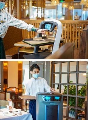 # Pudu Bot est en train d'aider le serveur à livrer les nourritures. # Hola Bot est en train d'aider le serveur à ramasser les assiettes. © Pudu Robotics