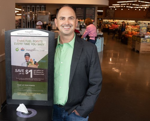 "Terraboost Media CEO Brian Morrison with a ""wellness kiosk."""