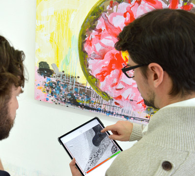 Artist Nico Mares and 4ART Director Dino Lewkowicz analysing the artwork condition using the 4ART app digital condition reports (Photo: Nico Mares)