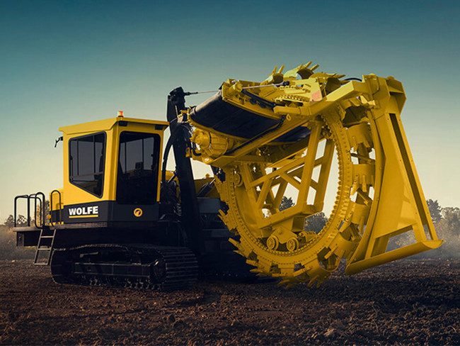 A Wolfe Trenching Machine ready for rental from Cross Country Infrastructure Services.