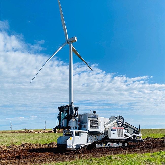 A Cross County SPD-250 EVO SCAIP Padding Machine working on a Wind Farm construction project.