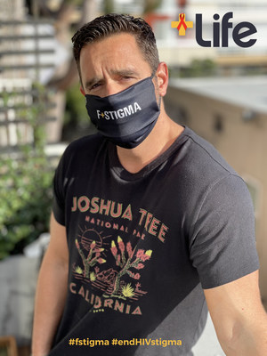 Karl Schmid, co-founder of +Life, wears the F+Stigma mask to fight HIV stigma in support of World AIDS Day (Dec. 1)
