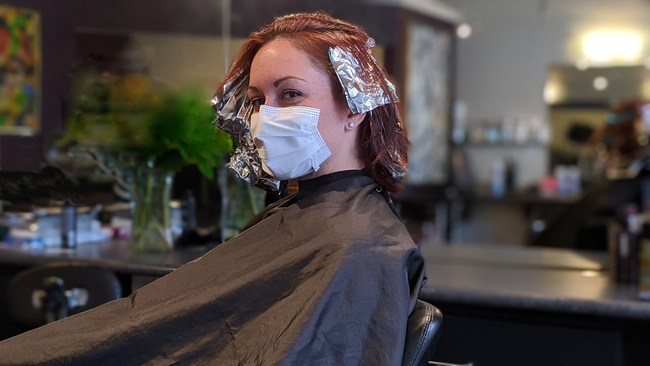 White SAM mask worn during a hair coloring process.