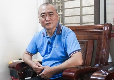 Wang Haibian at his house in Maniao, Lingao County, Hainan Province in south China, on November 18 (LI NAN)