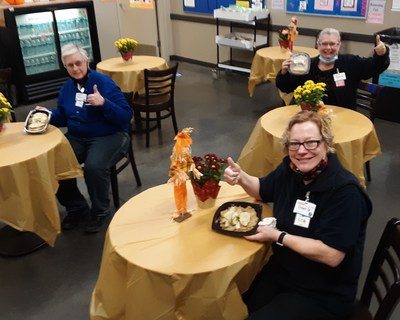 Meijer team members Melissa Abbott, Dawn Mackie and Cindy Wheeler enjoy locally prepared dishes from Timothy's Restaurant as a sign of appreciation for their frontline efforts.