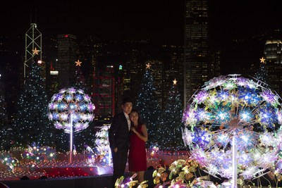 "Visitors enjoy ""Christmas Lighting & Music Show"" with the amazing skyline as a backdrop in Harbour City, Hong Kong. (PRNewsfoto/Harbour City Hong Kong)"