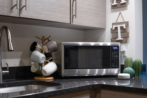 Sharp's first smart countertop microwave oven features Wi-Fi connectivity and certified Works with Alexa compatibility for hands-free operation using voice commands.
