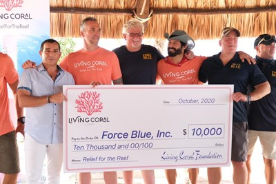 Giovanni Pecora, CEO Enovation Brands, Inc., presents a $10,000 check on behalf of Living Coral wine to Jim Ritterhoff, Executive Director, Force Blue, Inc. and members of the Force Blue dive team. (Pictured left to right, Giovanni Pecora, Geoff Reeves, Thomas Peck, Rudy Reyes, Jim Ritterhoff, Angelo Fiore)