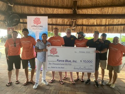 """Enovation Brands, Inc. presents a check for $10,000 from Living Coral to Force Blue, Inc. The group had just completed a dive on the 100 Yards of Hope site where they planted 1,000 corals. The 100 Yards of Hope mission is a partnership with NFL Green to restore a football field-length stretch of reef in the waters off Key Biscayne. (Pictured left to right, RJ Casey, Kaj Larsen, Giovanni Pecora, Geoff Reeves, Thomas Peck, Rudy Reyes, Jim Ritterhoff, Angelo Fiore, Steve """"Gonzo"""" Gonzalez)"""